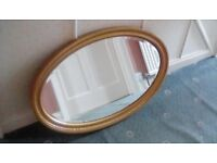 Large oval antique mirror