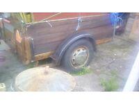 A heavey dutie car trailer big leaf spring wood and steel sides