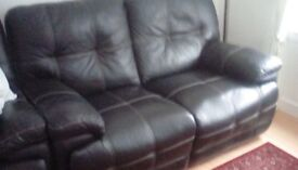 2 seater and 1 seater black leather recliners