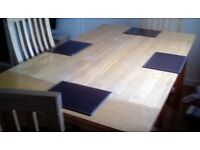 Solid wooden table with chairs