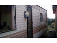 1980's static caravan with one double bedroom an one bunk bed room