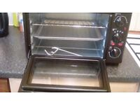 For Sale: Brand new mini oven with grill and double hobs.