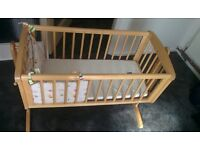 Mothercare swinging baby crib with bumper set and mattress