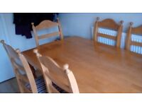 Large solid pine table and six matching chairs
