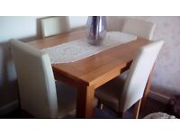 Four cream leather dining room chairs