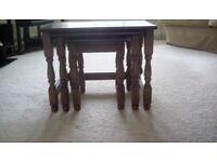 ,Nest of 3 mahogany tables.