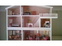 Three storey dolls house in excellent condition
