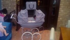 Double hooded Silver Cross dolls pram. Silver grey with bag, has been loved abd played with