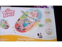 Brand new never opened baby chair vibrates has toys going across middle detachable from birth onward