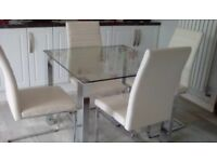 Glass and Chrome dining table and 4 Cream chairs