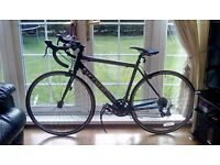 Carrera road bike excellent condition barely used