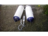 Two large boat fenders and boat anchor all in good used condition.