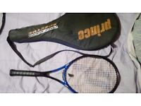 2 used adult tennis rackets with covers very good condition