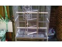 Large bird cage on a fixed stand