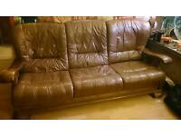 Solid oak and leather sofa and two chairs