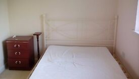 Double bed,cream headboard and footboard.