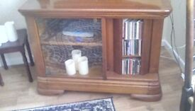 Solid wood glass fronted TV cabinet, including turning space for CD's