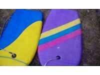 2 kids surfboards with attachable rope to wrist