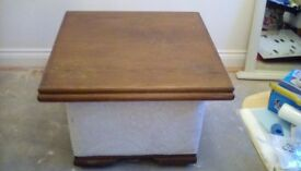 Solid wooden top and upholstered base occasional/lamp table