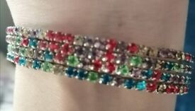Silver colour bangles with multi coloured diamonties.