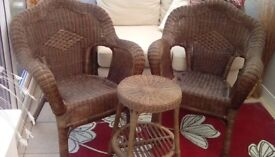 Two wicker armchairs with small table