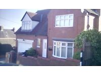 Detached House with Double Garage.