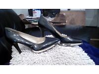 Stunning black shoes silver sole 4