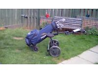 Golf clubs and electric trolley