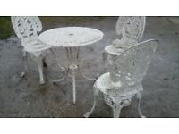 Metal patio table and three chairs