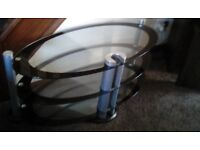 Glass oval TV stand. Good condition. Buyer to collect.