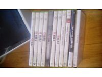 Black xbox 360 with 10 games 3 controls and a wifi adapter