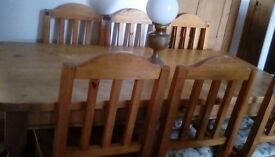 Solid pine dinning table plus six chairs and dresser.