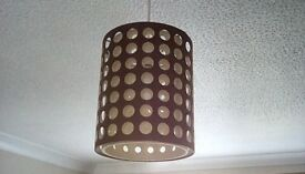 Two lampshades brown with cream circle design