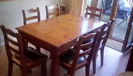Pine table with two draws and six chairs