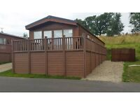 STATIC HOLIDAY LODGE FOR SALE £66,950, INCLUDING DECKING AND HOT TUB.