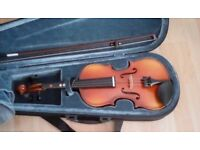 Half size violin with case.Ideal for child.Very good condition