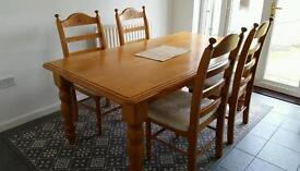 Solid oak table and 4 chairs, ready to go asap. Packed in boxes.