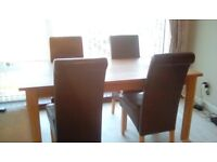 Solid oak dining table and 4 faux leather brown chairs
