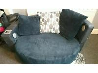 Dfs round settee with built in docking station and speakers for sale