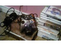 Xbox 360 all cables charges and 2 controllers with games