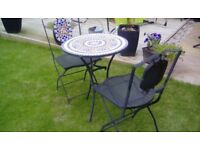 Mosaic table and chairs. Good condition.