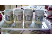 Rectangular plastic tray with matching china mugs