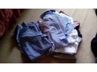 Bundle of young mens shirts.