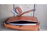 Ladies tan leather handbag/clutch brand new