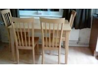 Dining table and 4 high back chairs solid wood