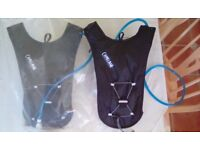 Two Camelbak water carriers