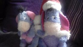 Two christmas Eeyore soft toys