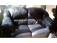 Free two seater blue leather sofa