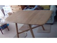 Ercol mid-century dining table, drop leaf, beautiful grain on top and legs. Has original label
