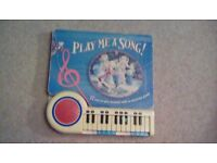 Children's nursery rhyme music book with mini electronic keyboard to play along